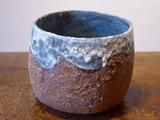 Stoneware bowl with textured<br/>rust body & turquoise rim & interior by Paul Philp
